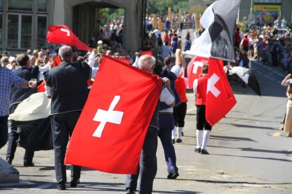 Swiss Flags at the Désalpe des Quinquas Parade in Fribourg, Switzerland