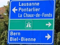 Road sign in Neuchatel pointing to Lausanne, Bern, Biel, Autoroute