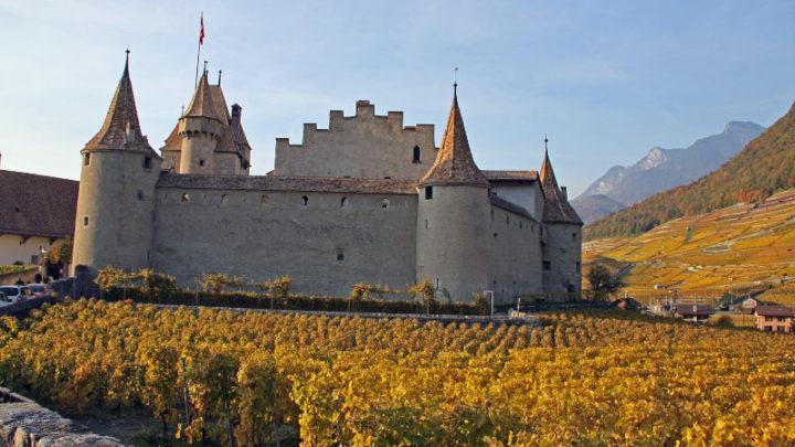 Autumn colors surrounds the Chateau d'Aigle Castle in Switzerland