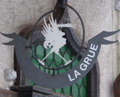 Crane Shop Sign in Gruyères, Switzerland