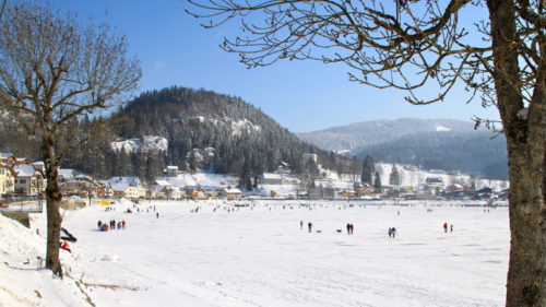 Ice-skaters on Lake Joux seen from Le Pont