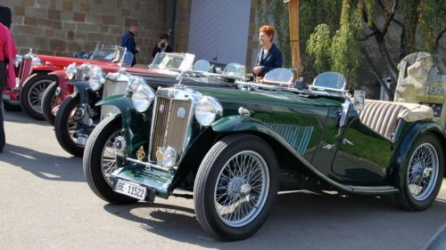 British Classic Cars Parked in front of the Chateau de Morges