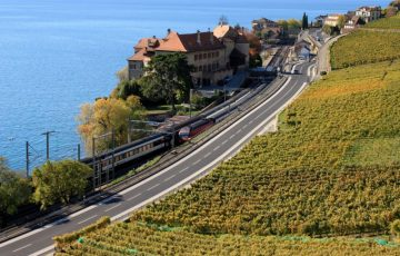 Train running through the Lavaux region of Lake Geneva