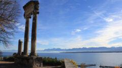 Roman pillar in Nyon with view of Lake Geneva