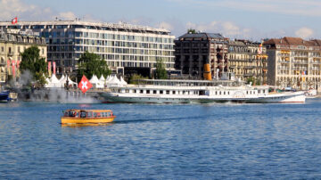 CGN's Simplon paddle steam boat in Geneva with a Mouette passenger ferry passing in the foreground.